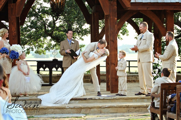 classic oaks ranch, first kiss, swan photography, rustic wedding, affordable DFW photographer, first kiss